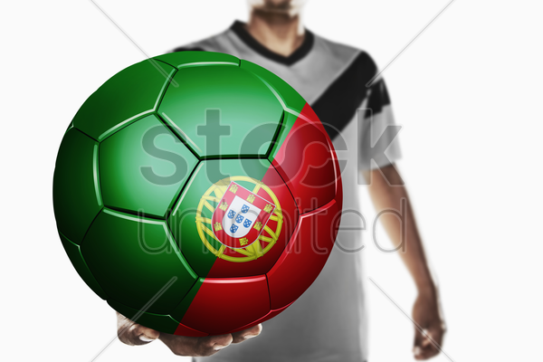 a soccer player holding portugal soccer ball stock photo
