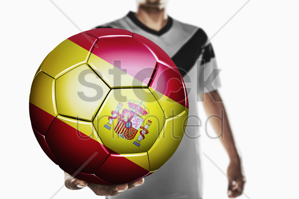 a soccer player holding spain soccer ball stock photo