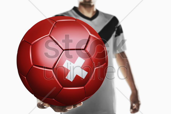 a soccer player holding switzerland soccer ball stock photo