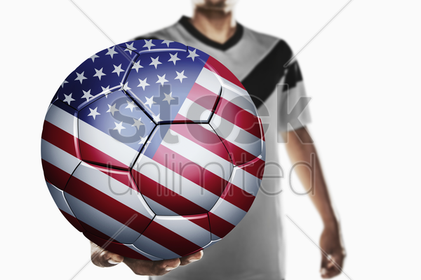 a soccer player holding united states of america soccer ball stock photo