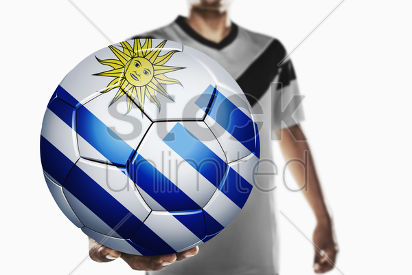a soccer player holding uruguay soccer ball stock photo