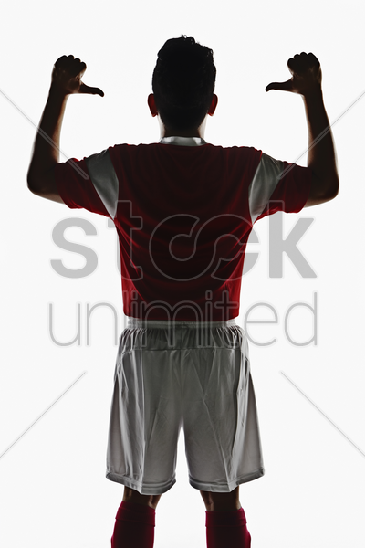 a soccer player showing his back stock photo