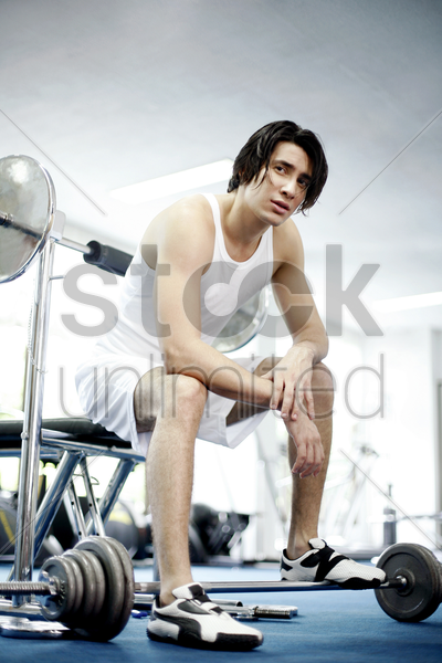 a tired guy in the gym stock photo