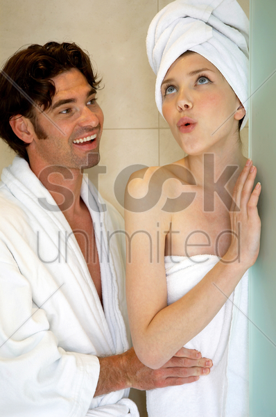 a woman disturbing her husband for having a bad breath stock photo