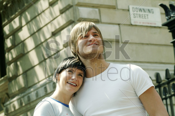 a woman leaning on her boyfriend's shoulder stock photo