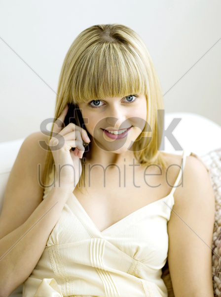 a woman on the mobile stock photo