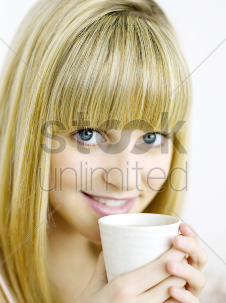 a woman with a cup of coffee stock photo