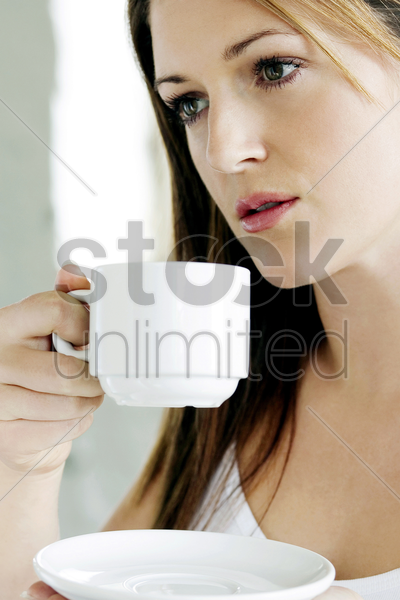 a young lady drinking coffee stock photo