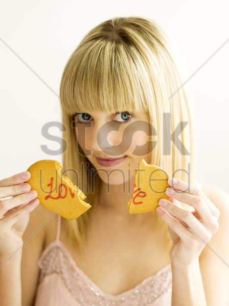 a young teen breaking the cookie stock photo