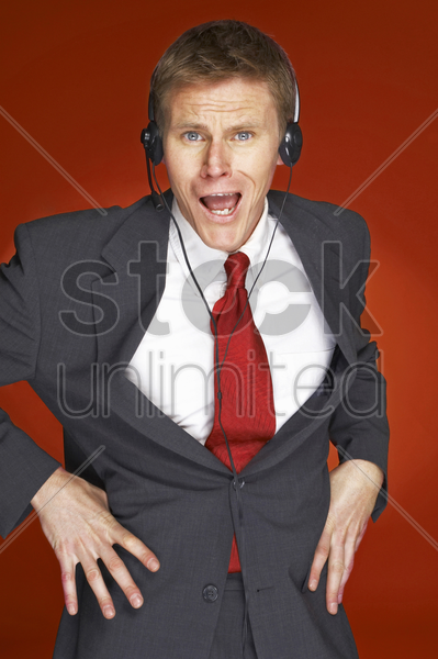 an angry looking man in business suit stock photo