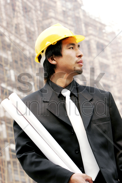 an architect at a construction site stock photo