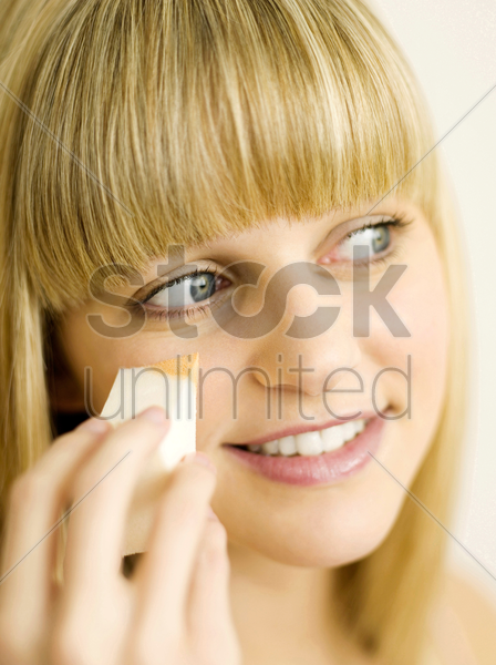 applying foundation stock photo