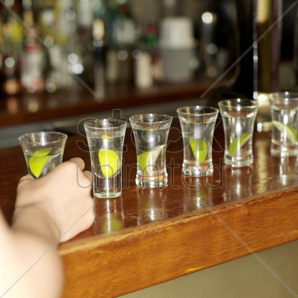 arranging the cocktails in a row stock photo