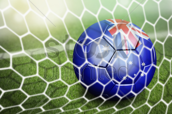 australia soccer ball in goal net stock photo