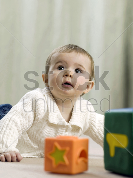 baby girl crawling on the floor stock photo