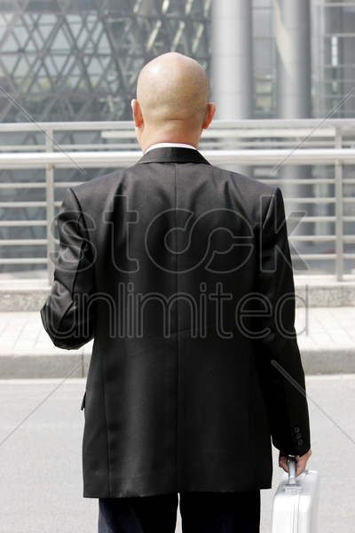 back shot of a bald man in business suit stock photo