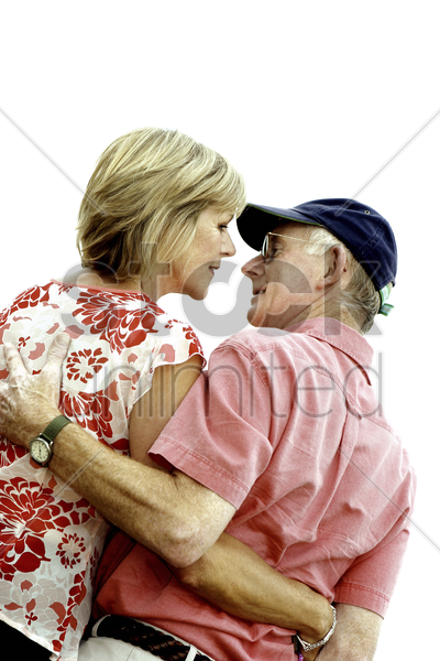 back shot of an old couple having eye contact stock photo