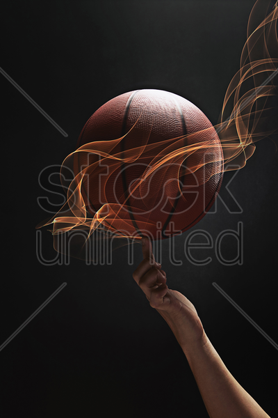 basketball spinning on index finger stock photo