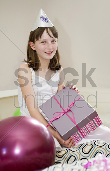 birthday girl holding her present stock photo