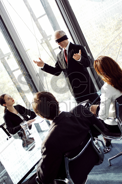 blindfolded businessman talking in the conference room stock photo