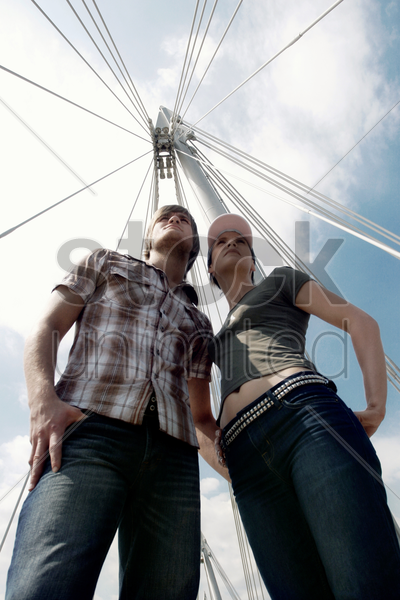 bottom view of a couple standing together under a hot sun stock photo