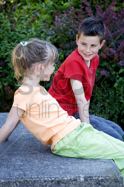 boy and girl chatting stock photo