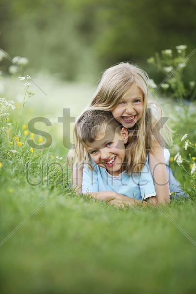 boy and girl having fun stock photo