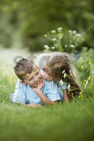 boy and girl looking at each other stock photo