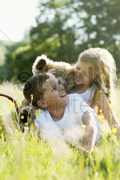 boy and girl smiling while looking at each other stock photo