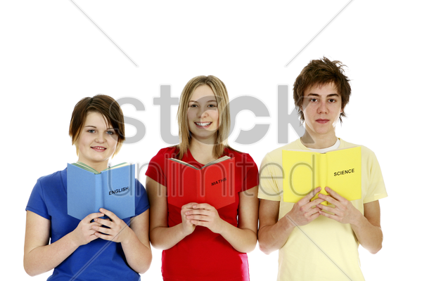 boy and girls reading different subject stock photo