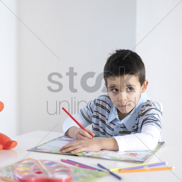 boy doing homework stock photo