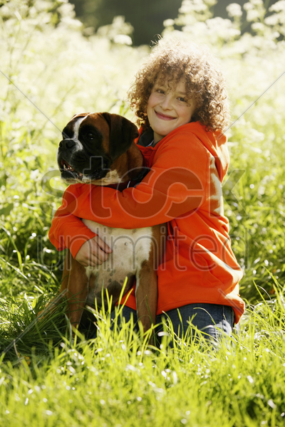 boy embracing dog stock photo