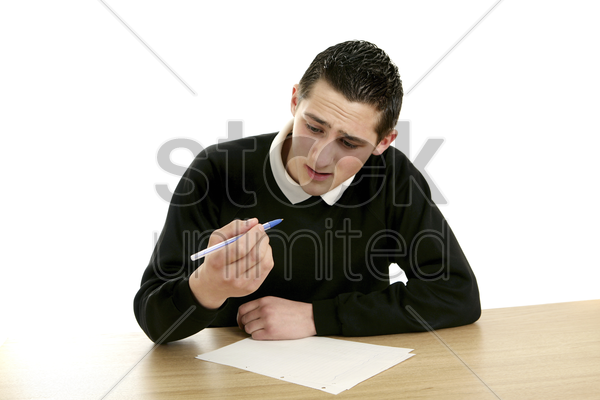 boy having problem with his pen stock photo
