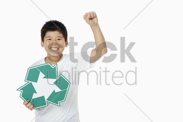 boy holding up a recycle logo stock photo