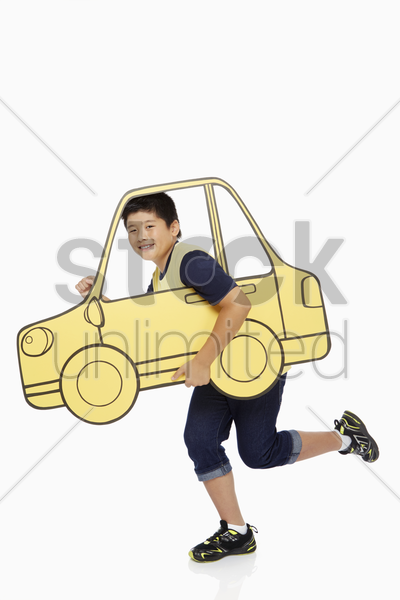 boy looking out a cardboard car window, stock photo