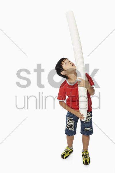boy playing around with a stack of disposable cups stock photo