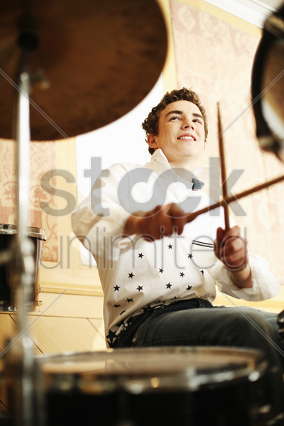 boy playing drum stock photo