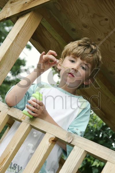 boy playing with bubbles stock photo