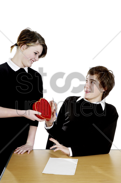 boy rejecting a lovely gift from his admirer stock photo