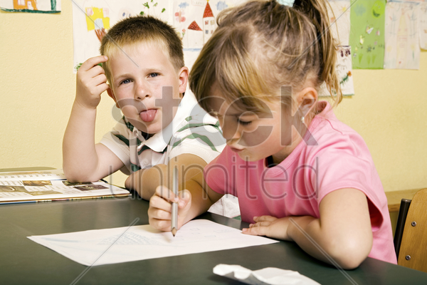 boy sticking out his tongue at the camera stock photo