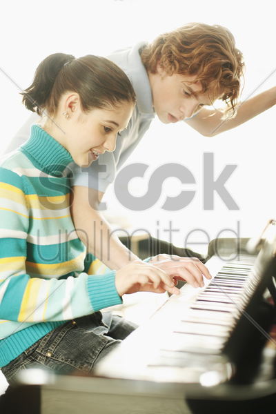 boy teaching his sister stock photo
