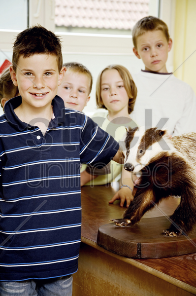 boys and girls posing with model bear in the classroom stock photo