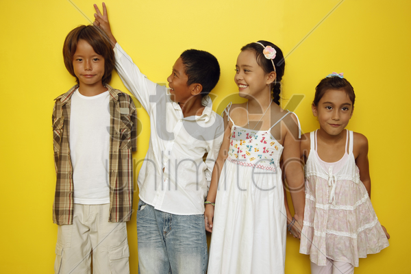 boys and girls standing in a row stock photo