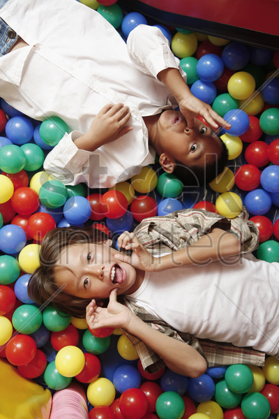 boys in ball pool, making funny faces stock photo
