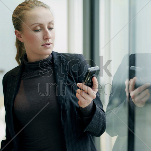 business lady using cell phone stock photo