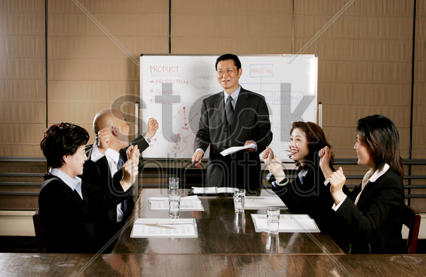 business man and women rejoicing their success stock photo