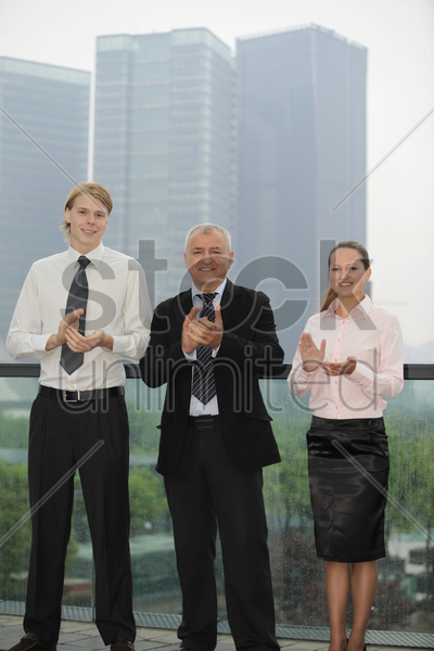 business people applauding stock photo