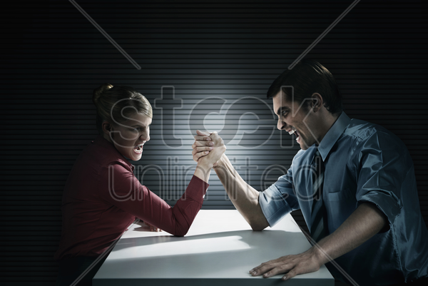 business people arm wrestling stock photo