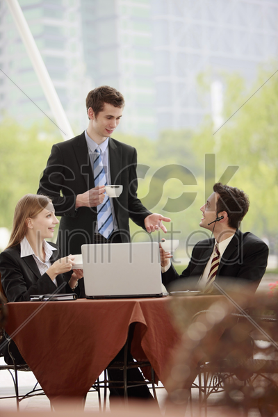 business people at outdoor cafe stock photo