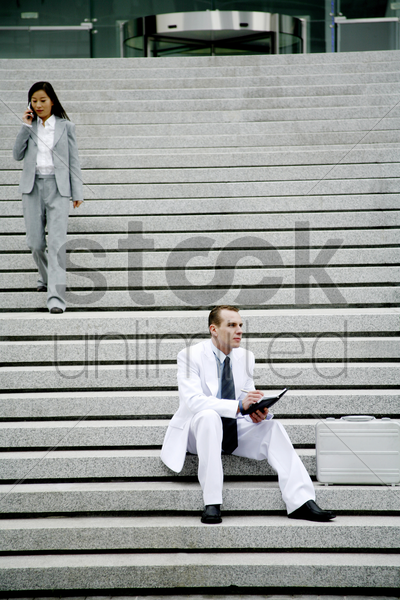 business people at the staircase stock photo